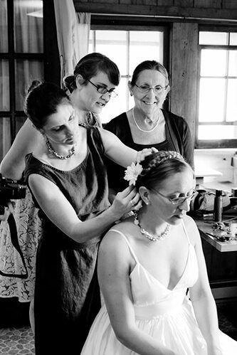 Wife and her bridesmaids getting ready for her wedding