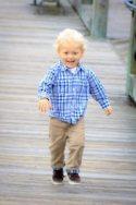 happy boy running down the dock