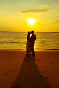 Beautiful Couple embrace on the beach in Charleston, SC