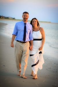 Beautiful Couple walking holding hands on the beach in Charleston, SC