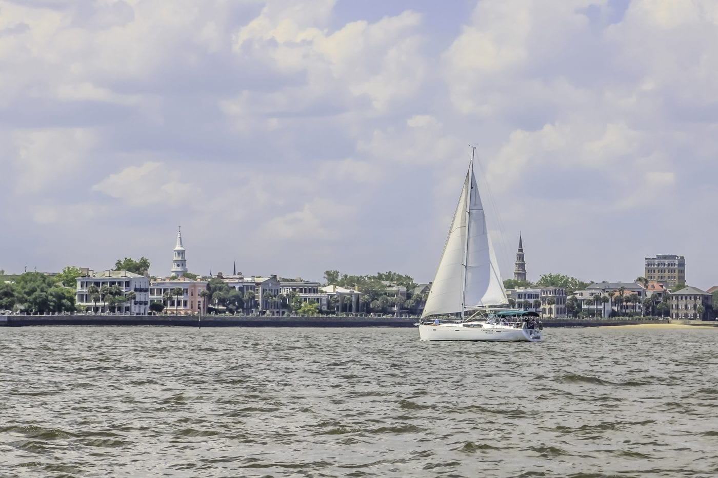 Sailboat infront of the city of Charleston, SC
