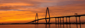 The Ravenell Bridge with the sunset behind it
