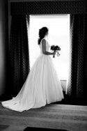 bride in a window sill