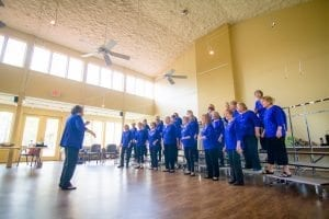 Vocal ensemble singing in concert hall